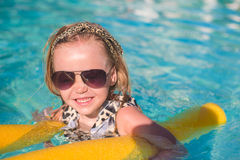 Little adorable girl enjoy in the swimming pool Royalty Free Stock Images