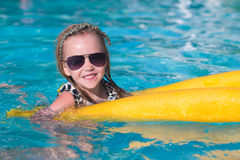 Little adorable girl enjoy in the swimming pool Stock Photos