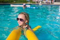 Little adorable girl enjoy in the swimming pool Stock Photography