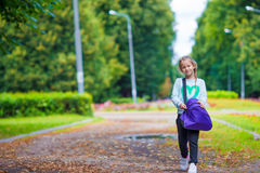 Little adorable girl going to the gym with her Stock Photography