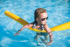 Little adorable girl have fun in the swimming pool Stock Images