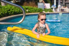 Little adorable girl have fun in the swimming pool Stock Image