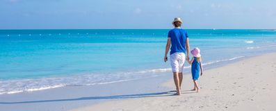 Little adorable girl and her father walking along Royalty Free Stock Photography