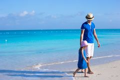 Little adorable girl and her father walking along the sea Royalty Free Stock Images