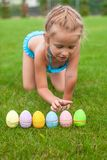 Little adorable girl holding an Easter egg on the Stock Photography