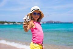 Little adorable girl with ice cream on tropical Stock Photos