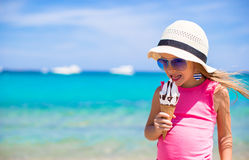 Little adorable girl with ice cream on tropical Stock Image