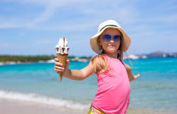 Little adorable girl with ice cream on tropical Royalty Free Stock Photos