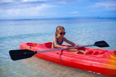 Little adorable girl kayaking in the clear sea Royalty Free Stock Photos