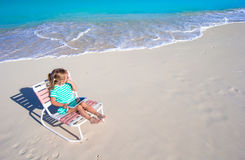 Little adorable girl with laptop on beach during Royalty Free Stock Photography