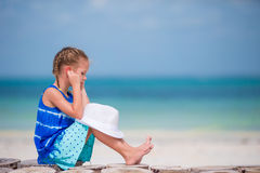 Little adorable girl listening to music on headphones on the beach Stock Photography