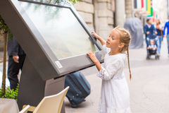 Little adorable girl looking the map of Milan Royalty Free Stock Photo