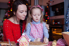 Little adorable girl and mother baking Christmas Royalty Free Stock Images