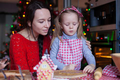 Little adorable girl and mother baking Christmas Royalty Free Stock Photos