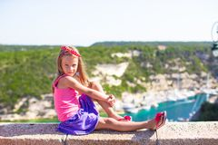 Little adorable girl outdoors with beautiful view Stock Images