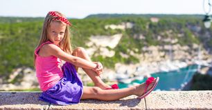 Little adorable girl outdoors with beautiful view Royalty Free Stock Photo
