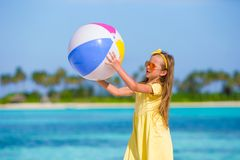 Little adorable girl playing with air ball outdoor Royalty Free Stock Photography