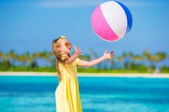 Little adorable girl playing with air ball outdoor Stock Photo