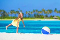Little adorable girl playing with air ball outdoor Stock Photography