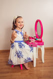 Little Adorable Girl Playing And Applying Makeup Royalty Free Stock Photography