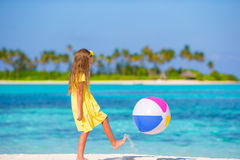 Little adorable girl playing on beach with ball. Little girl playing on beach with ball Stock Image