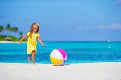Little adorable girl playing on beach with ball. Little girl playing on beach with ball Stock Photo