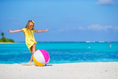 Little adorable girl playing on beach with ball. Little girl playing on beach with ball Royalty Free Stock Photo