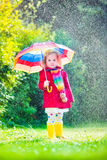 Little adorable girl playing in the rain Royalty Free Stock Photography
