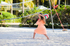 Little adorable girl playing voleyball on beach with ball Royalty Free Stock Photo