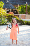 Little adorable girl playing voleyball on beach with ball Royalty Free Stock Images