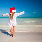 Little adorable girl in red Santa hat during Royalty Free Stock Photos