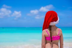 Little adorable girl in red Santa Hat enjoy beach Stock Images