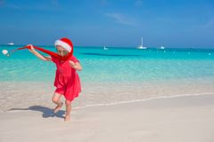 Little adorable girl in red Santa hat have fun on Royalty Free Stock Photography