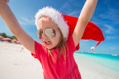 Little adorable girl in red Santa hat have fun on Royalty Free Stock Photo