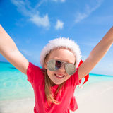 Little adorable girl in red Santa hat have fun on Stock Photography