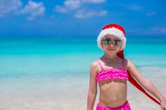 Little adorable girl in red Santa Hat on tropical Royalty Free Stock Images