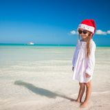 Little adorable girl in red Santa hat at tropical Royalty Free Stock Image
