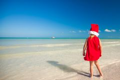 Little adorable girl in red Santa hat at tropical Royalty Free Stock Photography