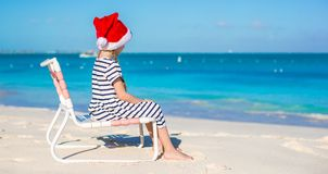 Little adorable girl in Santa hat at tropical Royalty Free Stock Image