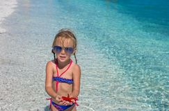 Little adorable girl with sea star at the tropical Stock Images