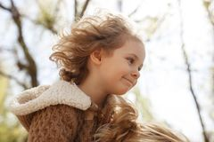 Little adorable girl sitting on her mother`s shoulders. Autumn outdoor. royalty free stock images