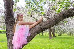 Free Little Adorable Girl Sitting On Blossoming Apple Royalty Free Stock Image - 40844366