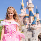 Little adorable girl in Sleeping Beauty dress at Stock Images