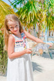 Little adorable girl with a small turtle in her hands in the reserve Royalty Free Stock Photo