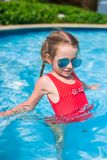Little adorable girl swimming in the swimmingpool Royalty Free Stock Photo