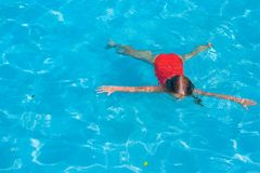 Little adorable girl swimming in the swimmingpool Stock Photos