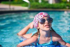 Little adorable girl swimming in the swimmingpool Royalty Free Stock Images