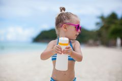 Little adorable girl in swimsuit shows suntan Royalty Free Stock Photos