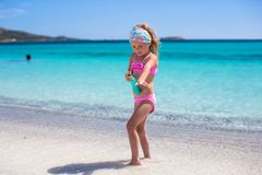 Little adorable girl in swimsuit with suntan Stock Photo