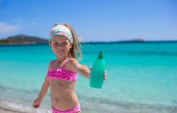Little adorable girl in swimsuit with suntan Royalty Free Stock Photo
